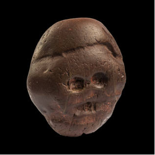 Description: https://www.britishmuseum.org/images/Makapansgat_Pebble_blackbackground_small.png